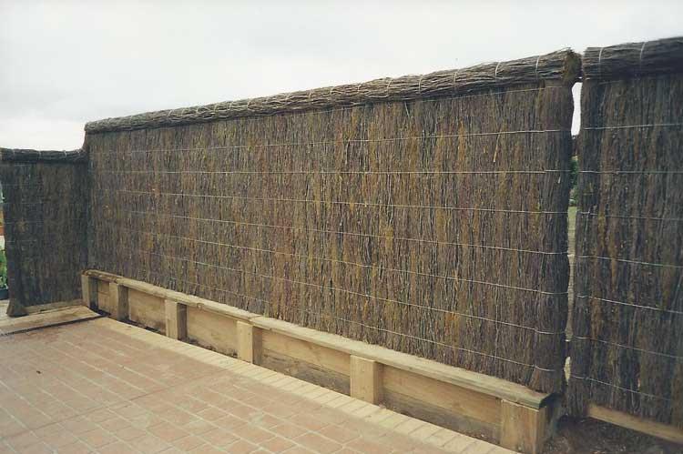brushwood-fence-with-bricks