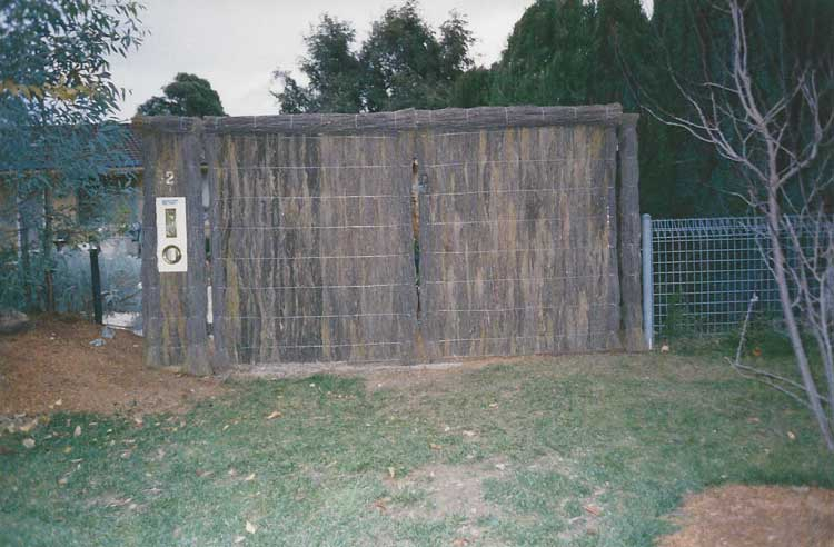 brushwood-fence-with-letter-box
