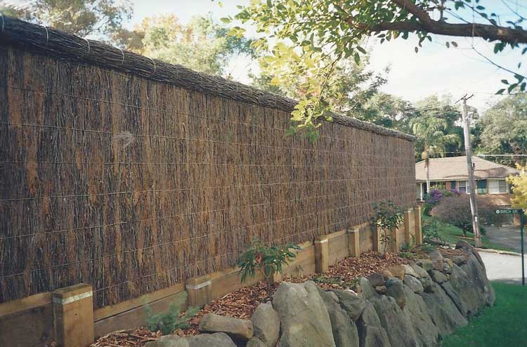 brushwood-fence-with-rock-wall
