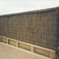 brushwood-fence-with-bricks